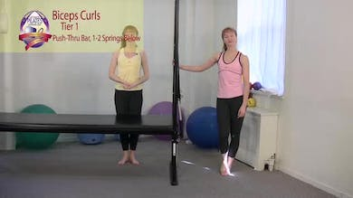 Biceps Curls Standing Push Thru Bar by Pilates on Fifth