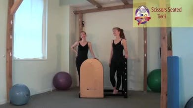Scissors Seated on the Ladder Barrel by Pilates on Fifth