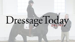 Cesar Torrente judges a ride and coaches the rider on asking the horse to sit improving contact and giving the reins by Dressage Today Online