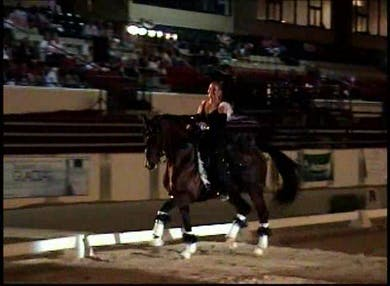 Yvonne Barteau performing her freestyle under the lights by Dressage Today Online