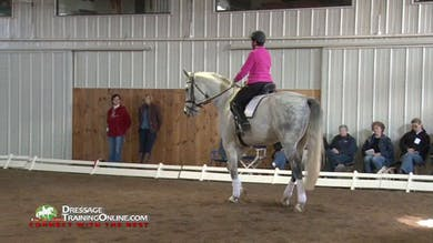 Ms. Fore assist Maribeth in riding through some disobediance and explains that the rider must also be responsible for demanding responsiveness.  She works with her to get responsiveness regardless of the rein contact. by Dressage Today Online