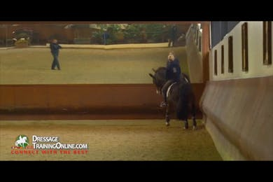 When asking for the extended canter down the long side, Dr. Möller asks the rider to maintain contact for the first two strides, build, and then give with the hand as he gets light. by Dressage Today Online