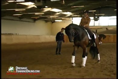 As they work the walk quarter pirouettes to the right, they think of forward and bending the shoulder in to the right to prepare for the movement. by Dressage Today Online