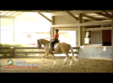 This segment begins with walk trot walk transitions using the inside leg.  Juan asks for a touch of the crop on the croup for collection and raising the neck. They work for a wonderful medium trot with a straight neck. by Dressage Today Online