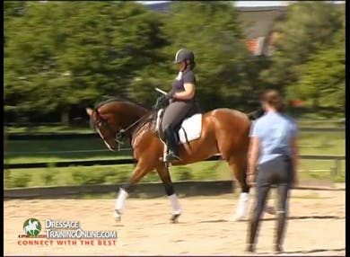 They reverse directions and Ms. Haddad gives exercises to help when he shows a tendency to fall in on the shoulder. by Dressage Today Online