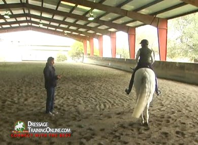 The passage work continues, with an explanation of making sure the horse keeps moving from behind and how it relates to being behind the leg.  Watch this intriguing segment to see them work through this issue and show some great passage steps.    by Dressage Today Online