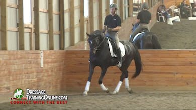 When the mare leans on the bit, Dr. Möller has the rider tap with the whip, remembering to release when she comes up. - Part 2 by Dressage Today Online