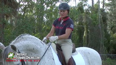Nancy Later Lavoie demonstrates how to hold the reins of a snaffle bridle. by Dressage Today Online