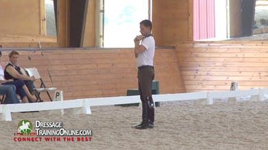 Nicholas talks about how he warms up which is to do a marching  walk with the neck low on both reins. - Part 1 by Dressage Today Online