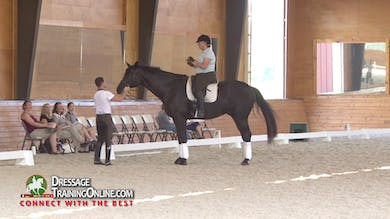 He asks her to walk with the poll lower than the withers to get him really reaching. - Part 1 by Dressage Today Online
