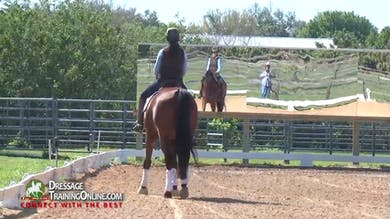 She discusses the frame she warms up in, and how she does not hold him in this frame but lets him find what is comfortable. - Part 1 by Dressage Today Online