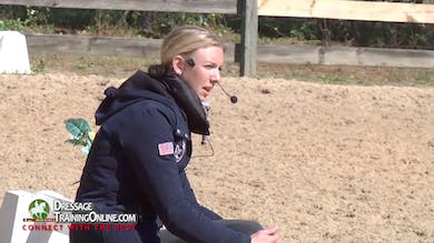 They talk about how they warm him up and how they stretch him before asking for a collected walk to extended walk. - Part 1 by Dressage Today Online