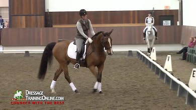 Debbie continues helping the rider with the change because as soon as she changes the bend the horse gives the change. - Part 4 by Dressage Today Online