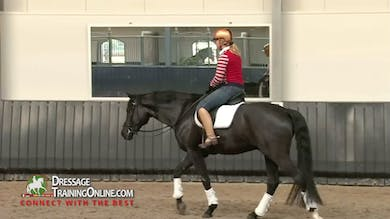 After a walk break Joyce works the canter to the right, lengthening and shortening the stride as well as spiraling in and out. - Part 3 by Dressage Today Online