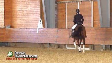 Janet discusses the problems that arise when overbending in the canter. - Part 2 by Dressage Today Online