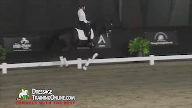 They move onto the canter and flying changes continuing to work on keeping the horse forward. - Part 2 by Dressage Today Online