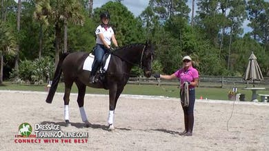 Nancy Later teaches a lunge line lesson to help develop the sitting trot with an independent seat and rein aids. - Part 1 by Dressage Today Online