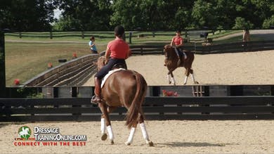 Catherine has the rider visit the canter pirouettes and explains how they work with a horse that is slightly behind the leg in the pirouettes. - Part 2 by Dressage Today Online