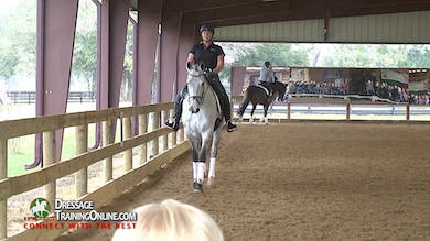 Janet explains that the balance for First Level is the same as for Training Level- a level balance that is not on the forehand. - Part 1 by Dressage Today Online