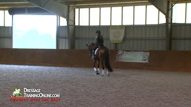 Gary Rockwell watches this beautiful mare warm up, encouraging the rider to keep her hands in front of the saddle. - Part 1 by Dressage Today Online