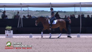 After reviewing the warm up they work on keeping the mare going with a light-footed, active canter and ride transitions within the gait. - Part 2 by Dressage Today Online