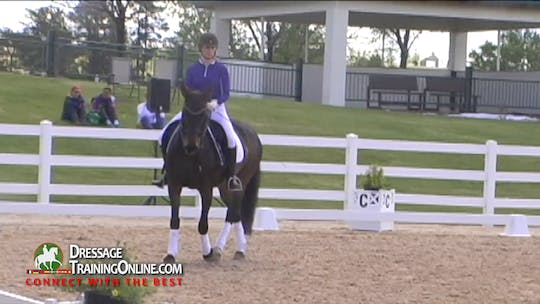 Instant Access to Lars now has her work on tempi changes without counting in a leg yield zig zag and keeping her straight in the stride after the change. by Dressage Today Online, powered by Intelivideo