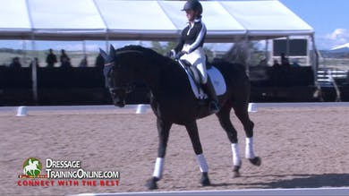 When they come back to the canter the mare expresses her opinion, and Steffen helps her work through it diplomatically. - Part 3 by Dressage Today Online