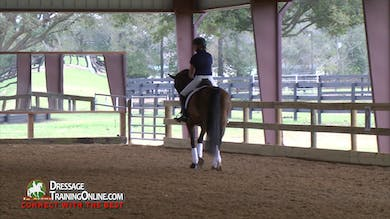 Janet has the other rider start with the walk pirouettes to the canter depart in 4-1, pointing out how similar the aids are for those two movements. - Part 3 by Dressage Today Online