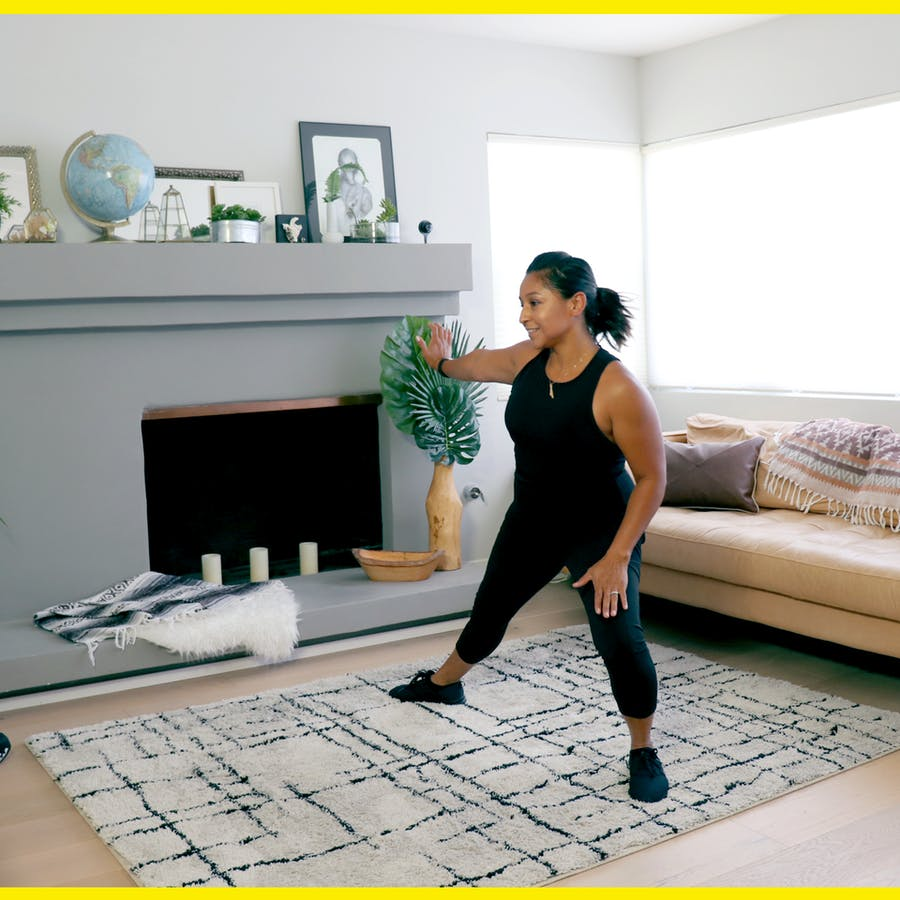 Black-haired woman exercising at home in her living room